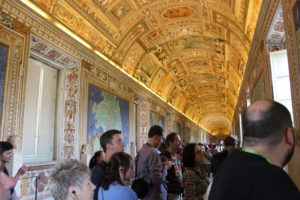 Gallery of Maps.  The depictions on the ceiling are correlated to the maps below them.